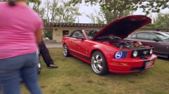 New and old Ford Mustangs Stock Footage