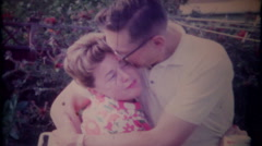 3213 a couple share hugs & kisses at garden party - vintage film home movie - stock footage