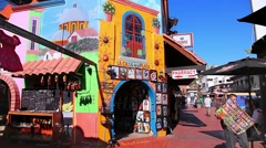 Torists visit shopping area in Ensenada, Mexico Stock Footage