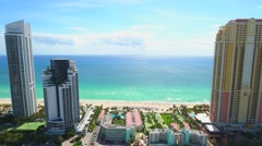 Sunny Isles backwards aerial video sped up Stock Footage