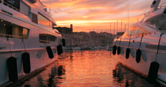 Luxury expensive yachts boats yacht boat sunset Cannes France marina harbour Stock Footage