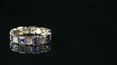 bracelet with many stones on reflective background - stock footage