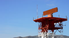 Tower with radar gyrating in airport at sunny day - stock footage