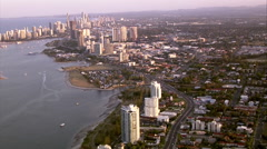 Aerial shot of Southport flying towards Gold Coast city at dusk Stock Footage