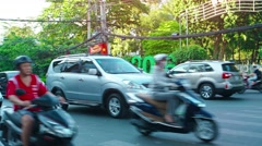 Typical traffic along a major urban street in Ho Chi Minh City, with sound - stock footage