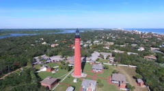 High aerial video moves up to the Ponce de Leon lighthouse with ocean on right Stock Footage