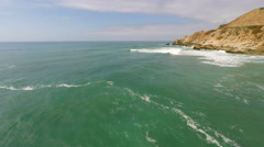 Green Pacific Ocean tracking shot from Ocean to shore break Stock Footage