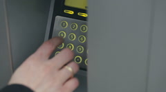 Person Enters PIN Code on an ATM Stock Footage