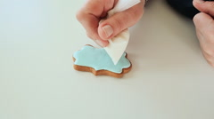 Woman master decorating gingerbread colored glaze. Female silhouette - stock footage