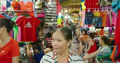 Many clothing vendors at an indoor public market in Ho Chi Minh City Stock Footage