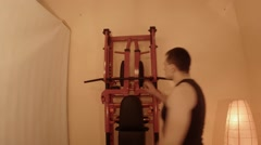 Young Man Opens a Horizontal Bar on the Wall Bars in the Room Stock Footage