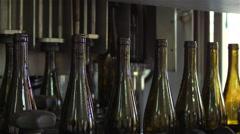 Bottles on a industrial machine. Bottling machine. Stock Footage