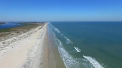 High aerial video of waves crashing on the St. Augustine beach - stock footage