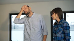 Couple fighting, arguing over blueprints at their new home - stock footage