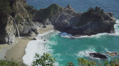 Wide shot of McWay falls waterfall Stock Footage