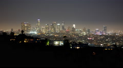 4K time lapse of the downtown Los Angeles city skyline and houses at night Stock Footage