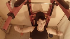 Man Makes Exercises With Bar on Wall Bars in the Room Top View Stock Footage