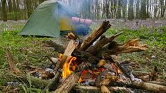 Slow motion. BonFire, campfire in wood  and  tent  with  backpack. Stock Footage