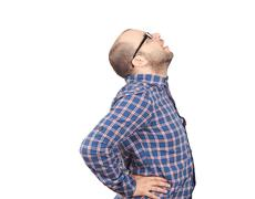 Caucasian man  with intense back pain - stock photo