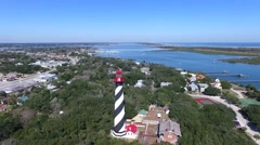High aerial video of the St. Augustine lighthouse viewing ocean in background Stock Footage