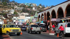 Traffic on the major street of tropical city of Ensenada, Mexico Stock Footage