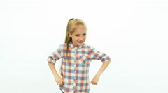 Cute girl dancing on the white background and smiling at camera - stock footage