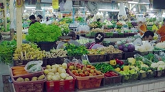 Abundance of fresh vegetables and produce at an indoor public market in Phuke - stock footage