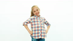 Laughing girl child looking at camera on the white background - stock footage