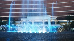 Fountain show in the performance lake of Wynn Macao, a luxury hotel and casin - stock footage