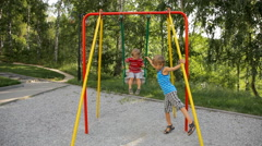 Sway on swing at playground Stock Footage