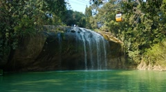 Suspended passenger cable car crosses Prenn Waterfall. Stock Footage