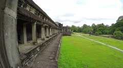 Overlooking view of a grassy field inside the ancient walls of Angkor Wat Stock Footage