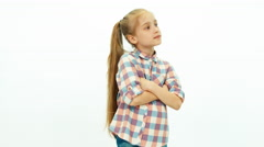 Laughing girl in the shirt standing on the white background and smiling Stock Footage