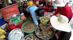 SIHANOUK, Cambodia - Cambodian Women Selecting Fresh Prawns. - stock footage