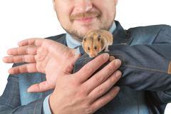 Man holding hamster on arm Stock Photos
