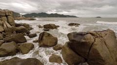 Ocean waves splash over the Hon Chong Rocks in Nha Trang. Stock Footage