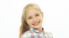 Portrait 7-8 years old girl in the shirt standing on the white background - stock footage