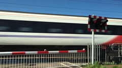 Virgin Trains on a level crossing on the East Coast mainline in Cambridgeshire. Stock Footage