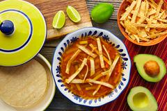 Mexican tortilla soup and aguacate - stock photo