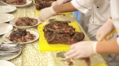 Chef carving roast pork Stock Footage