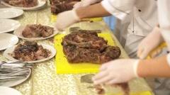 Chef carving roast pork Stock Footage
