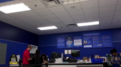 One side of service counter in Walmart store Stock Footage