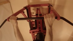 Ull-Ups on the Bar on the Wall Bars in Home Gym Stock Footage