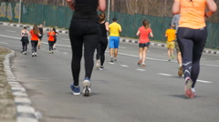 City marathon. Feet of people. Legs of runners on the city street. Stock Footage