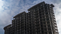 Unfinished residential house and clouds. Abandoned construction 4K time lapse Stock Footage