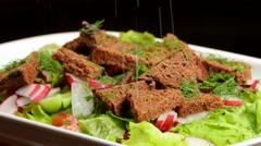 Vegetable salad on a plate rotation Stock Footage