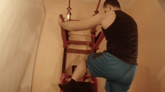 Man Doing Abdominal Exercises Lying on the Wall Bars Stock Footage