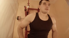 Man Doing a Bench Press Using a Barbell in the Room Stock Footage