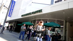 One side of Starbucks coffee on sunny day in downtown Vancouver Stock Footage