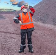 The woman in working to protective clothes Stock Photos